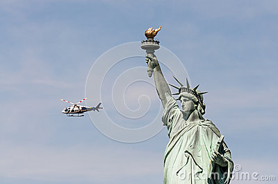 NYPD helicopter near Statue of Liberty, USA Editorial Photo