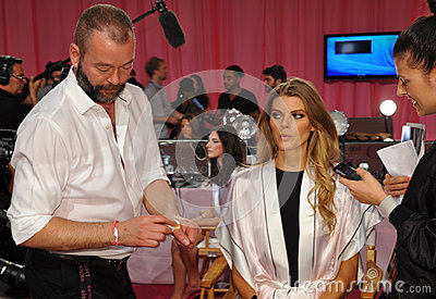 NEW YORK, NY - NOVEMBER 13: Makeup Artist Dick Page applying make-up to Maryna Linchuk at the 2013 Victoria s Secret Fashion Show Editorial Image