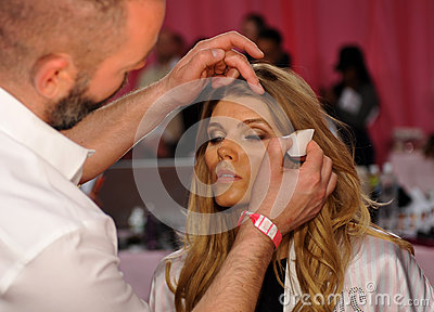 NEW YORK, NY - NOVEMBER 13: Makeup Artist Dick Page applying make-up to Maryna Linchuk at the 2013 Victoria s Secret Fashion Show Editorial Photo