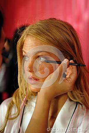 NEW YORK, NY - NOVEMBER 13: Model Erin Heatherton prepares at the 2013 Victoria s Secret Fashion Show Editorial Stock Photo