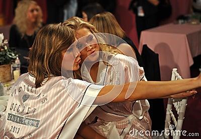 NEW YORK, NY - NOVEMBER 13: Models Karlie Kloss ( L) Toni Garrn (R) making faces for phone snapshots backstage Editorial Image