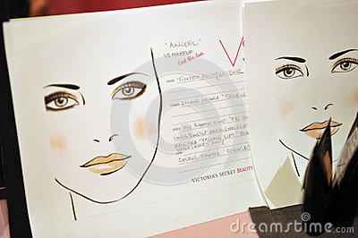 NEW YORK, NY - NOVEMBER 13: A view of atmosphere and make-up instructions backstage at the 2013 Victoria s Secret Fashion Editorial Stock Image