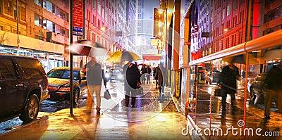 New York people commuting in rain