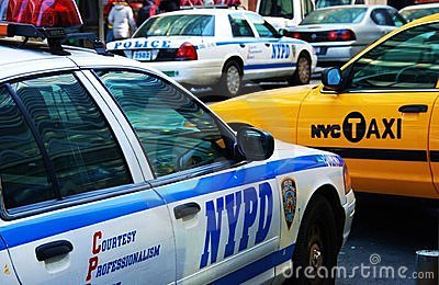 New York taxi and NYPD police cars Editorial Stock Image