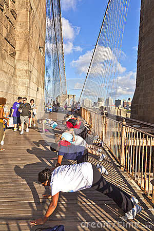 People exercise push-ups at Brooklyn bridge in New York City Editorial Image