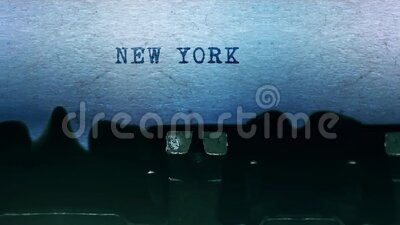 NEW YORK words Typing on a sheet of paper with old vintage typewriter. stock video footage