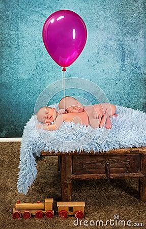 Newborn babies with balloon
