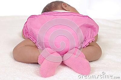 Newborn baby bottom in pink
