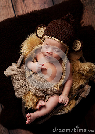 Newborn Baby Boy Wearing a Monkey Hat