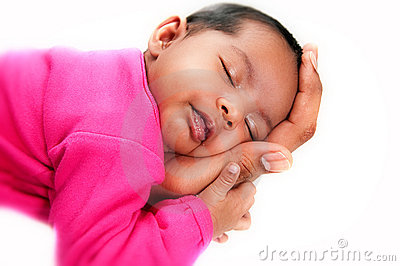 Newborn baby girl peaceful and asleep in hands