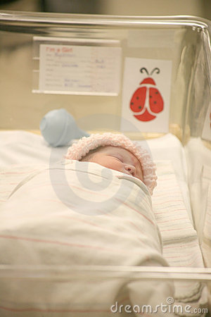 Newborn baby in a hospital blanket asleep