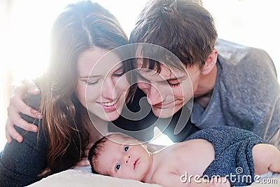 Newborn baby meeting parents