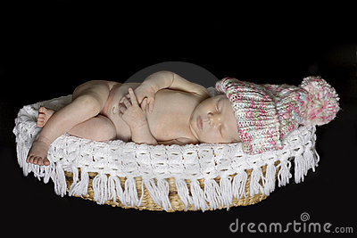 Newborn Baby Sleeping on Basket wearing hat