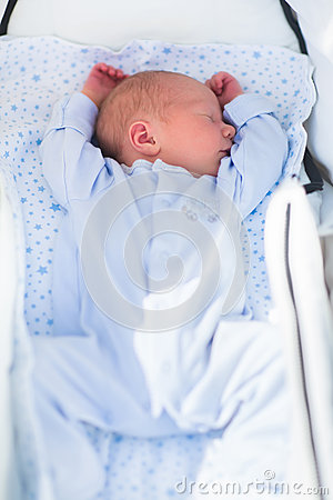 Free Newborn Baby Sleeping In White Stroller Stock Photos - 62759093
