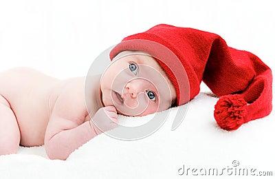 Newborn baby sleeps in a hat