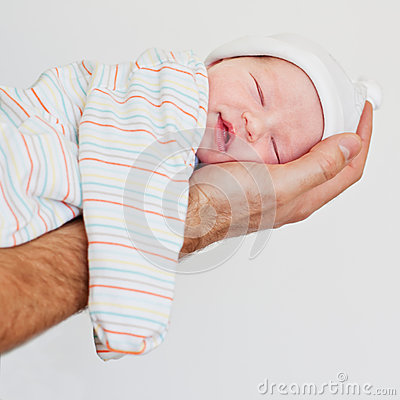 Newborn baby smiling in his sleep