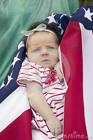 Newborn baby warpped in American flag Editorial Stock Photo