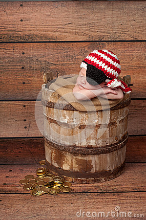 Newborn Baby Wearing A Pirate Hat And Eye Patch Stock