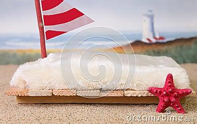 Newborn backdrop prop of a raft near the beach.