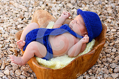 Newborn boy wearing blue fedora, tie, diaper cover