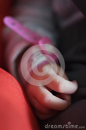 Newborn hand with id bracelet