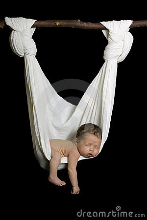 Newborn sleeping peacefully in white hammock
