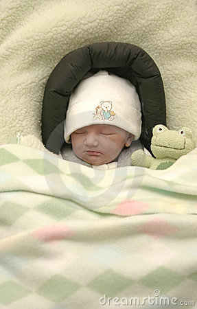 Newborn snuggled with Froggy