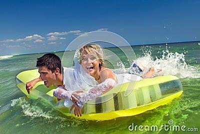 Newly-married couple enjoying beach