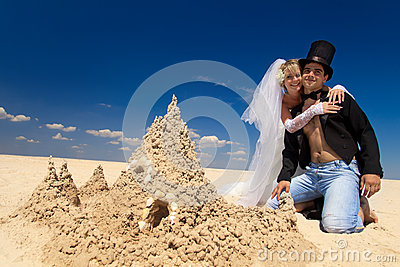 Newly-married couple enjoying on the beach