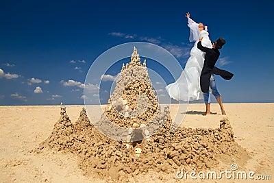 Newly-married couple enjoying o the beach