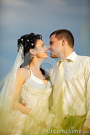 Newly-married couple in field
