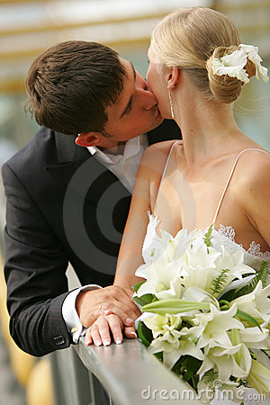 Newly Married Couple Kissing