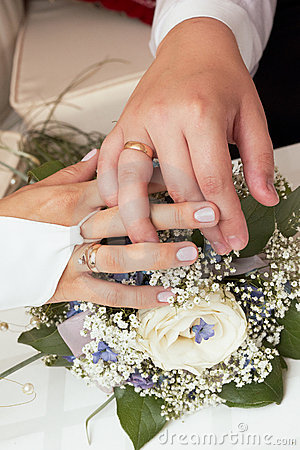 Newly-married couple showing wedding rings