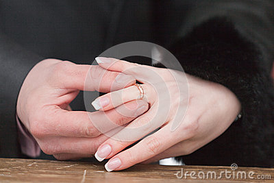 Newly-married couple on wedding dresses gold rings
