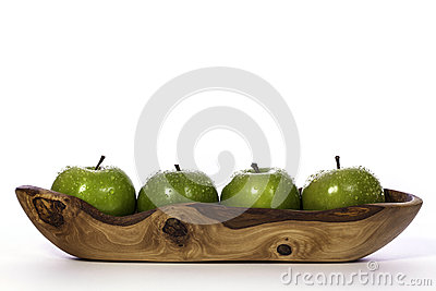 Newly washed green apples in olive wood bowl