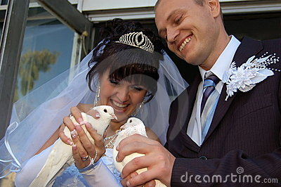 Newly wedded couple with doves