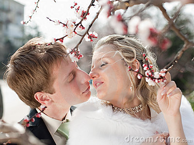 Newly wedded couple outdoors