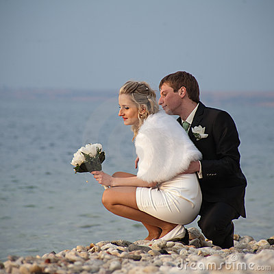 Newly wedded on seashore
