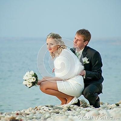 Newly wedded on seashore
