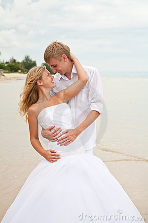 Newly wedding couple in love on a beach
