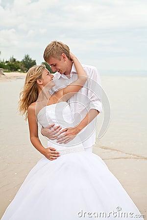 Newly wedding couple in love on a beach
