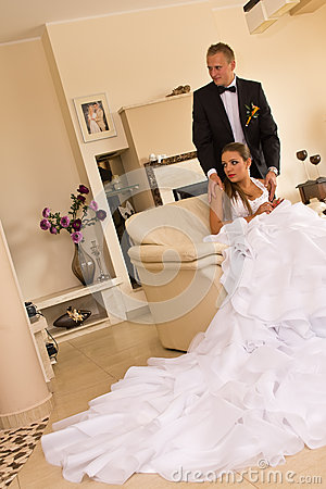 Newlywed couple in bedroom