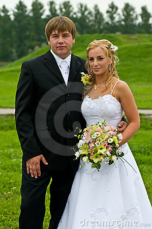 Newlywed couple in countryside