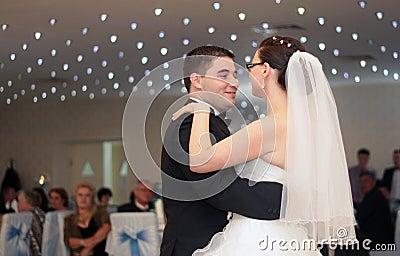 Newlywed couple dance
