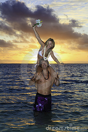 Newlywed couple in the ocean