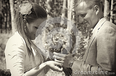Newlywed couple with pigeon