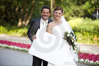 Newlywed couple with sign