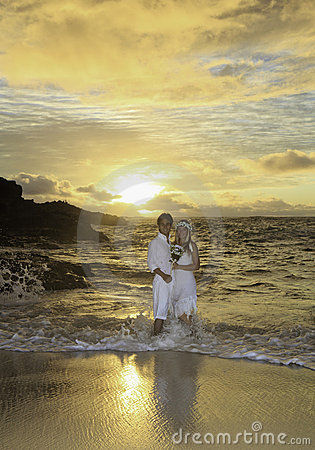 Newlywed couple at sunrise