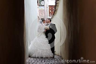 Newlywed couple about to kiss