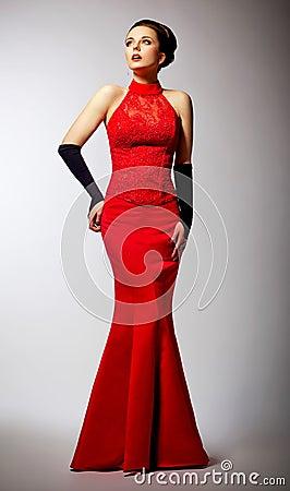 Newlywed in long wedding red dress posing